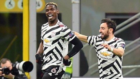 Paul Pogba feirer matchvinner-scoringen mot AC Milan i Europa League sammen med Bruno Fernandes.
