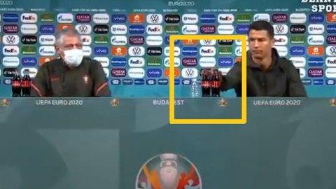 ELLERS TAKK: Cristiano Ronaldo ville ikke sitte bak Cola-flaskene på pressekonferansen før møtet med Ungarn.