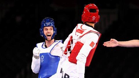 TAP I BRONSEFINALEN: Richard Ordemann (i blått) var nær en norsk OL-medalje mandag ettermiddag.