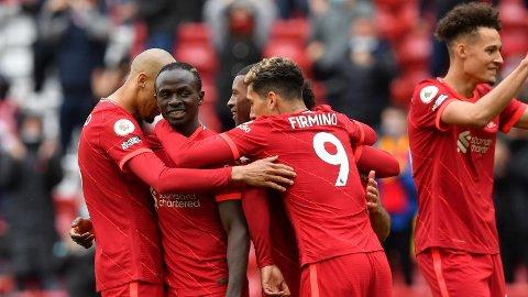Sadio Mane (nummer to fra venstre) scoret kun elleve mål i Premier League sist sesong. Vi tror han scorer flere denne sesongen, og at han åpner målkontoen mot Norwich lørdag.