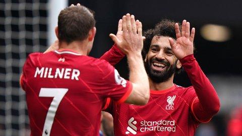 Mohamed Salah (t.h.) og James Milner jubler etter seieren mot Watford i helgen.