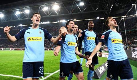 Möenchengladbachs tyske landslagsspiss Lars Stindl (nummer to fra venstre) jubler sammen med lagkameratene etter scoringen sin mot Fortuna Dusseldorf i februar.
