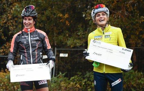 Marit Bjørgen (til venstre) måtte se seg slått av Therese Johaug i et rulleskirenn på Tryvann i september. Men Bjørgen vinner imidlertid lønnskampen, viser ferske tall.