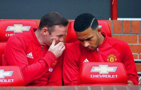 HEMMELIGHETER? Vet disse to Manchester United-inbytterne noe vi andre ikke vet? Wayne Rooney (til venstre) og Memphis Depay kan trolig vente seg solide tilbud fra andre klubber.
