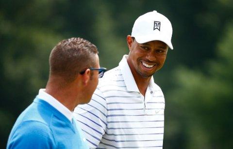BRYTER: Golfess Tiger Woods og trener Sean Foley.