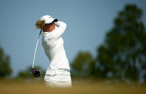 FIKK RÅD: Suzann Pettersen fikk hjelp av selveste Tiger Woods.