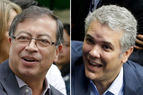 Venstresidens Gustavo Petro (t.v.) og den konservative Ivan Duque møttes i den andre valgomgangen av presidentvalget i Colombia. Foto: AP / NTB scanpix