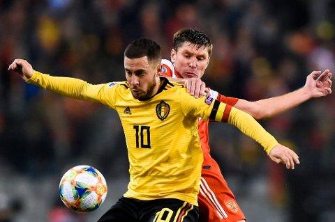 FIKSET TRE POENG: Eden Hazard ordnet målene som skaffet Belgia en perfekt start på EM-kvalifiseringen hjemme mot Russland.