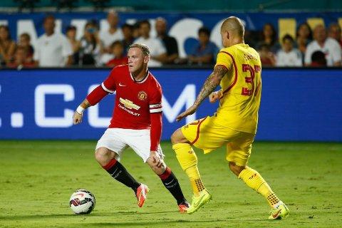 SCORET: Wayne Rooney satte inn 1-1 i møtet med Liverpool.