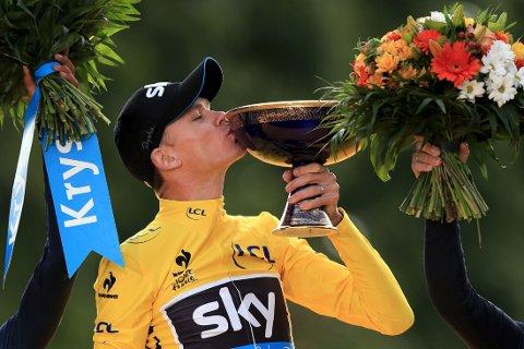 SAMMENLAGTSEIER: Chris Froome lot den 21. og siste etappen av årets Tour de France være en parademarsj opp Champs-Élysées.