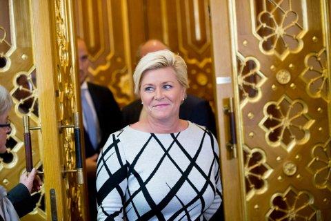OMSTRIDT AVGIFT: Finansminister Siv Jensen vil gi norske flypassasjerer en ekstra avgift på 88 kroner per flytur. Dette får partileder Siv Jensen og og Fremskrittspartiet svi for på meningsmålingene.