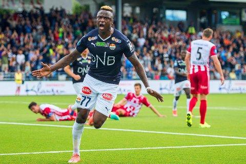 ORDNET SEIER: Strømsgodsets Muhamed Keita hadde god grunn til å juble etter målet som avgjorde hjemmekampen mot Tromsø.