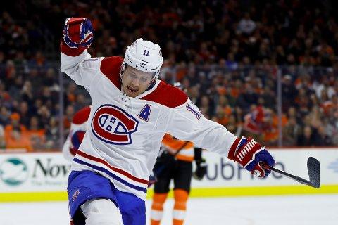 Montreal Canadiens og Brendan Gallagher jubler etter å ha scoret mot Philadelphia Flyers natt ti onsdag. De slo Flyers 3-1, men de trenger flere poeng om de har tenkt seg til Stanley Cup-sluttspillet. (AP Photo/Matt Slocum)