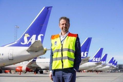 LOVER Å BETALE: Selv om SAS skylder kundene mye mer enn det selskapet har på konto forsikrer pressesjef John Eckhoff at kundene skal få refusjon.