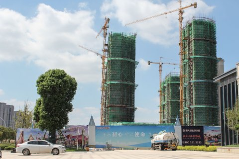 GJELDSTUNGT: Det kinesiske eiendomsselskapet Evergrande tynges av gjeld og skaper usikkerhet i finansmarkedene.