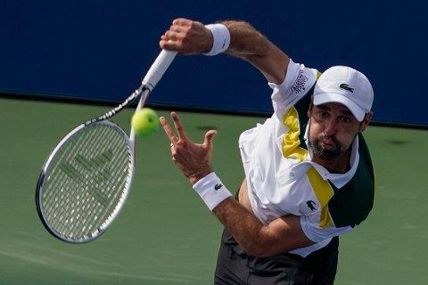 Jeremy Chardy har avbrutt tennissesongen etter å ha fått en reaksjon på koronavaksine. Foto: Seth Wenig, AP / NTB