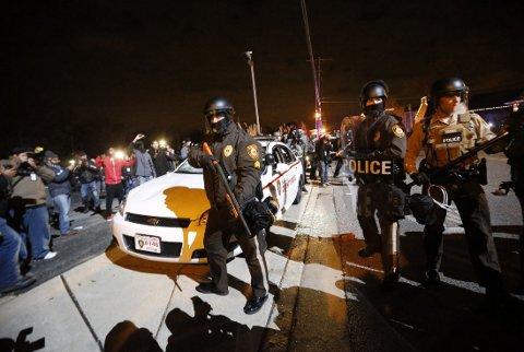 OPPTØYER: Gjennomgangen kommer samme uke som opptøyer har brutt ut i flere amerikanske byer i kjølvannet av Michael Brown-saken i Ferguson.