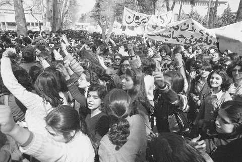 Iranian woman demonstrates for equal rights with other young women in Western clothes in Tehran on Monday, March 12, 1979. She told the photographer she was protesting with the hope her daughters will no longer have to wear the traditional chador. (AP Photo/Tomkins)