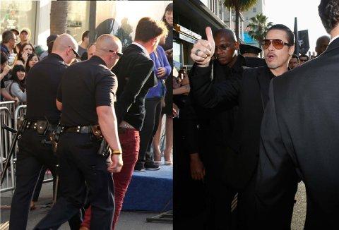 ACTION PÅ LØPEREN: Brad Pitt ble angrepet av denne mannen på den røde løperen i Los Angeles.