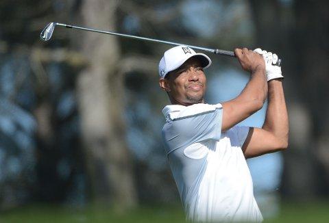 SLITER MED SMERTER: Tiger Woods har vondt i ryggen.