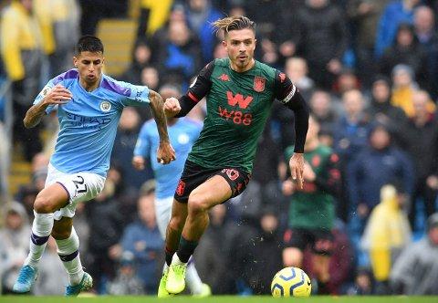 OMTALT: Både Aston Villa-kaptein Jack Grealish (til høyre) og Manchester Citys João Cancelo figurerer i ryktespaltene på den første dagen i mai.