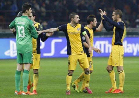 GODT UTGANGSPUNKT: Atletico Madrid-spillerne jubler for 1-0-seieren over AC Milan.