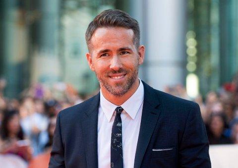 Ryan Reynolds på rød løper til filmen «Mississippi Grind» i Toronto. På hjemmebane nyter han tilværelsen som småbarnsfar.