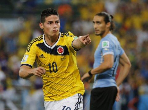 PERFEKSJON: James Rodriguez og Colombia slo til med to drømmemål da et Uruguay uten Luis Suarez ble slått i åttedelsfinalen.