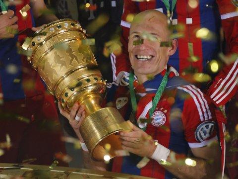 VIL BLI: Arjen Robben har hatt en flott sesong i Bayern München, og forteller at han ikke har noen planer om å forlate klubben til fordel for Manchester United.