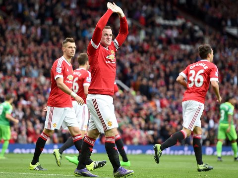 Manchester United's Wayne Rooney celebrates scoring their second goal of the game during the Barclays Premier League match at Old Trafford, Manchester.