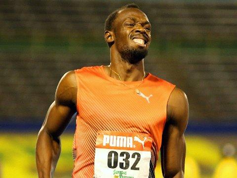 SKADE: Usain Bolt var tydelig preget etter å ha vunnet både kvartfinalen og semifinalen i Jamaicas nasjonale mesterskap.