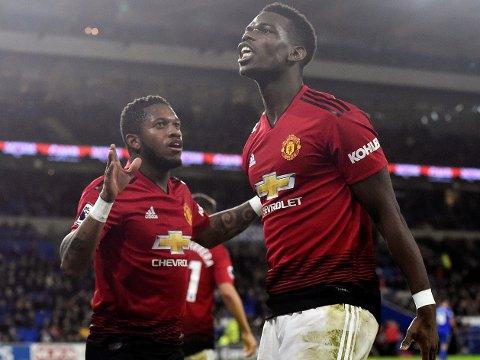 FORNØYDE KARER: Fred (til venstre) og Paul Pogba fikk en skikkelig opptur med Manchester United borte mot Cardiff i Wales. Førstnevnte ønsker i alle fall å bli værende i klubben på sikt.