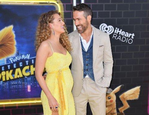 """TREBARNSFORELDRE: Skuespillerparet Ryan Reynolds og Blake Lively har blitt foreldre igjen. Her er de på premieren av """"Pokemon Detective Pikachu"""" i New York tidligere i år. (Photo by Angela Weiss / AFP)"""