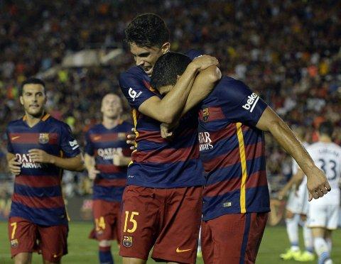 SCORET: Luis Suarez jubler for mål.