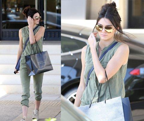 VÅRLIG: Kendall Jenner så både vårlig og trendriktig ut da hun gikk på shopping i en mosegrønn jumpsuit. Foto: Bulls