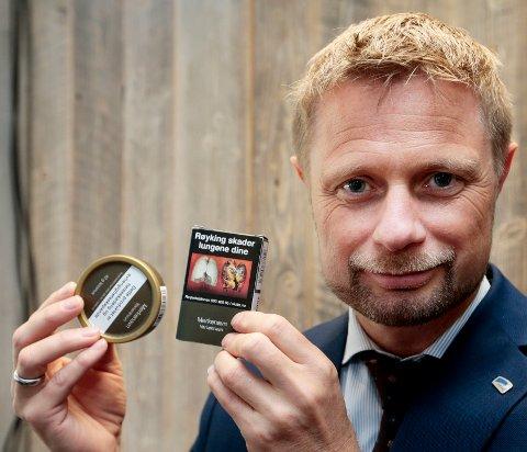 FORNØYD: Helse- og omsorgsminister Bent Høie fikk gjennomslag for standardiserte pakker på snus og røyk.