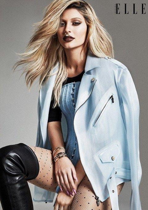 FORSIDEPIKE: Det kan se ut som om Kylie Jenner følger i storesøster Kendall sine fotspor. Her er hun på forsiden av Elle. Foto: Elle