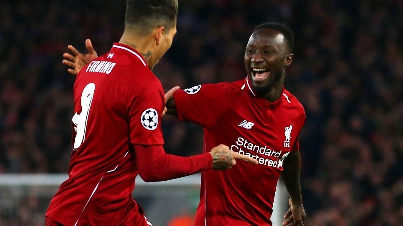 Liverpool's Naby Keita celebrates with Roberto Firmino, left, after scoring the opening goal during the Champions League quarterfinal, first leg, soccer match between Liverpool and FC Porto at Anfield Stadium, Liverpool, England, Tuesday April 9, 2019.