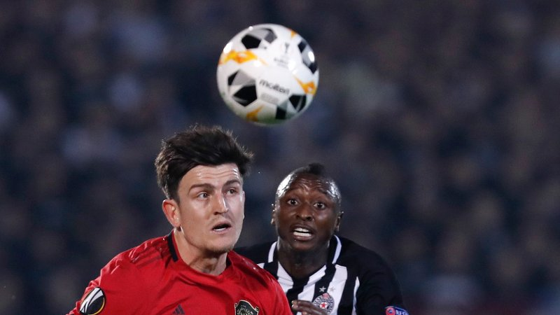 Manchester United's Harry Maguire challenges for the ball with Partizan's Umar Sadiq during the Europa League group L soccer match between Partizan Belgrade and Manchester United at the Partizan stadium in Belgrade, Serbia, Thursday, Oct. 24, 2019.