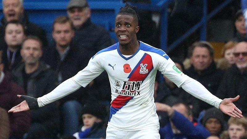 Crystal Palace's Wilfried Zaha appears frustrated during the Premier League match at Stamford Bridge, London.