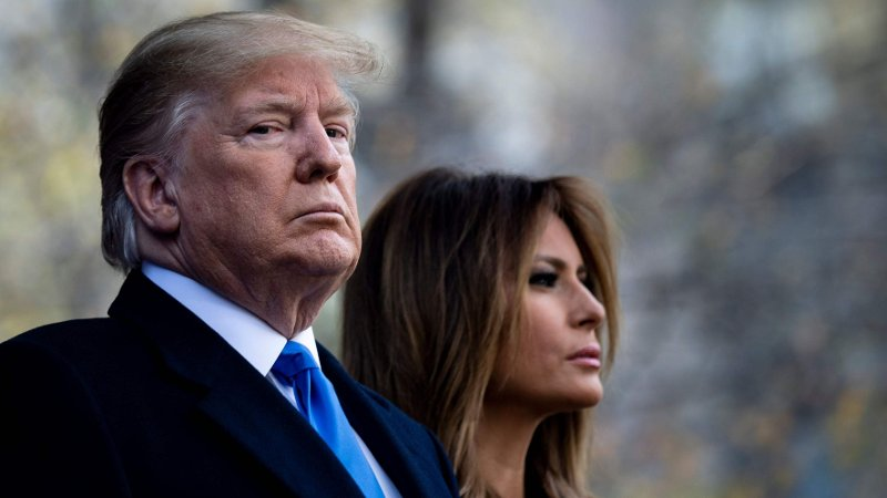 US President Donald Trump and US first Lady Melania Trump listen to Taps during a Veterans Day event at Madison Square Park November 11, 2019, in New York, New York.