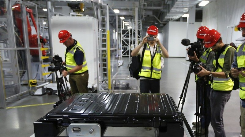 A Tesla battery pack is displayed during a media tour of the new Tesla Motors Inc., Gigafactory Tuesday, July 26, 2016, in Sparks, Nev. It's Tesla Motors biggest bet yet: a massive, $5 billion factory in the Nevada desert that could almost double the world's production of lithium-ion batteries by 2018.
