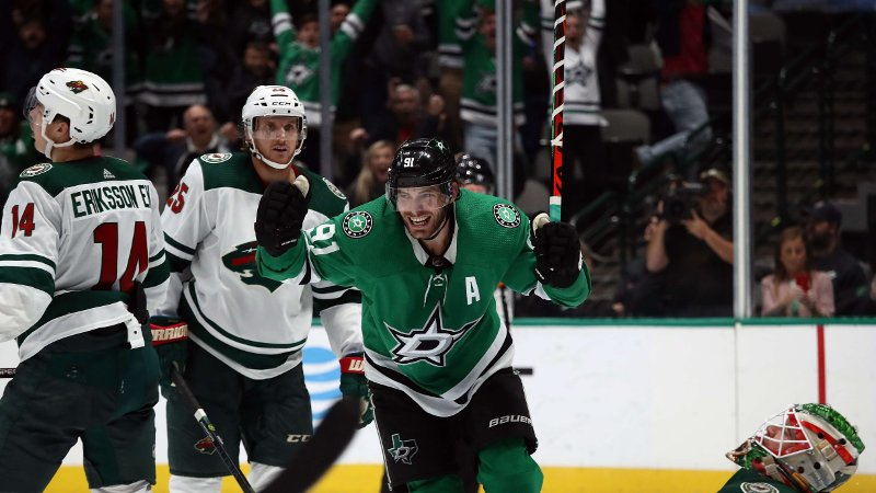 DALLAS, TEXAS - OCTOBER 29: Tyler Seguin #91 of the Dallas Stars celebrates a goal in front of Alex Stalock #32 of the Minnesota Wild in the third period at American Airlines Center on October 29, 2019 in Dallas, Texas. Ronald Martinez/Getty Images/AFP == FOR NEWSPAPERS, INTERNET, TELCOS & TELEVISION USE ONLY ==