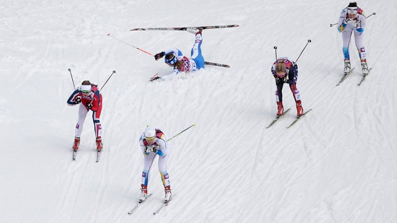 Italy's Greta Laurent, top left, as, from left, Norway's Ingvild Flugstad Oestberg, Sweden's Ida Ingemarsdotter, Canada's Daria Gaiazova, and Sweden's Norgren Britta Johansson pass by during their women's quarterfinal heat of the cross-country sprint at the 2014 Winter Olympics, Tuesday, Feb. 11, 2014, in Krasnaya Polyana, Russia.