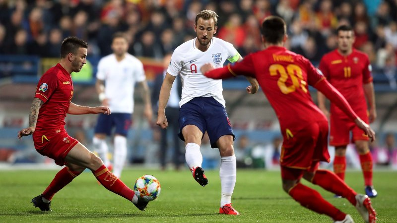 England's Harry Kane under pressure from Montenegro players during the UEFA Euro 2020 Qualifying, Group A match at the Podgorica City Stadium.