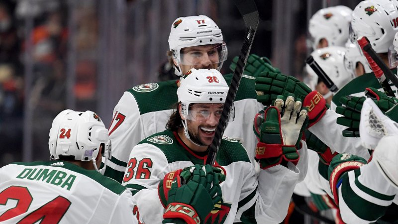ANAHEIM, CALIFORNIA - NOVEMBER 05: Mats Zuccarello #36 of the Minnesota Wild celebrates his goal with Matt Dumba #24 and Marcus Foligno #17, to tie the game 2-2 with the Anaheim Ducks during the third period in a 4-2 Wild win at Honda Center on November 05, 2019 in Anaheim, California. Harry How/Getty Images/AFP == FOR NEWSPAPERS, INTERNET, TELCOS & TELEVISION USE ONLY ==
