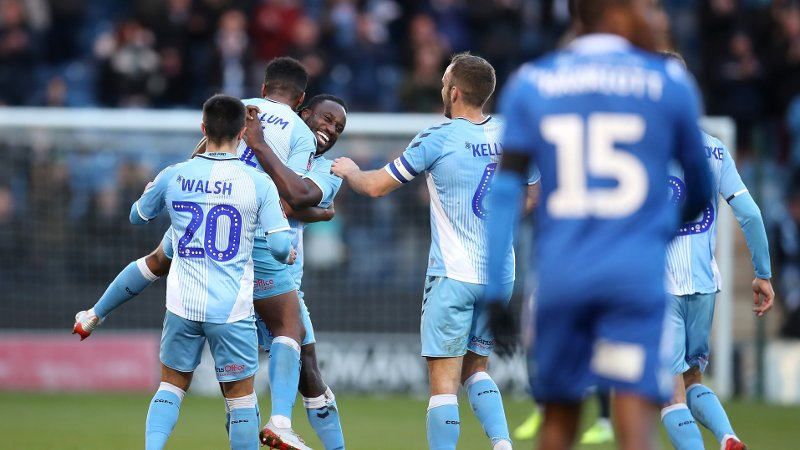 Coventry City's Sam McCallum is congratulated by team mates after scoring his side's second goal from a free kick during the Sky Bet League One match at the JobServe Community Stadium, Colchester, Essex.