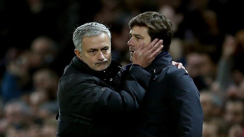 Jose Mourinho manager of Manchester United consoles Mauricio Pochettino manager of Tottenham during the English Premier League match at Old Trafford Stadium, Manchester. Picture date: December 11th, 2016. Pic Simon Bellis/Sportimage via PA Images