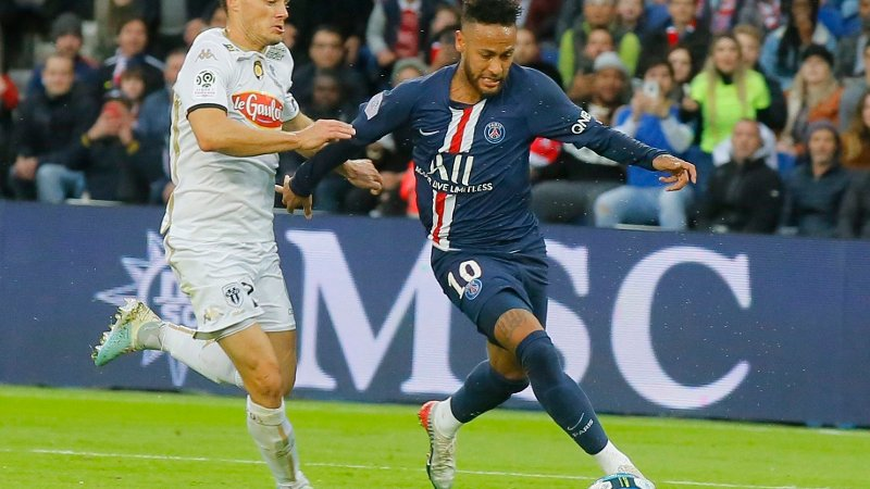 Angers' Rachid Alioui, left, and PSG's Neymar battle for the ball during French League One soccer match between PSG and Angers at the Parc des Princes stadium in Paris, Saturday, Oct. 5, 2019.