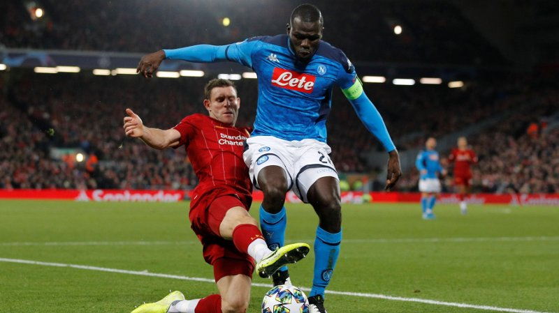 Soccer Football - Champions League - Group E - Liverpool v Napoli - Anfield, Liverpool, Britain - November 27, 2019 Napoli's Kalidou Koulibaly in action with Liverpool's James Milner REUTERS/Phil Noble